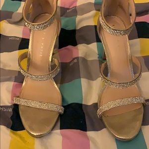Gold heels size 7.5 with silver band gems.